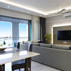 Apartment at Tata Primanti, Gurugram:  Living room by The Workroom