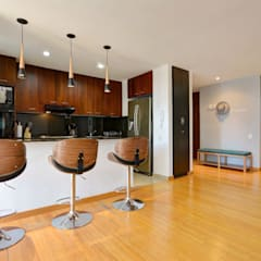 Gauss, disfruta cada espacio: Armarios de cocinas de estilo  por Natalia Mesa design studio