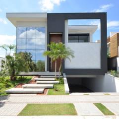 Fachadas Moderna Pele de Vidro: Casas  por Andréa Generoso - Arquitetura e Construção