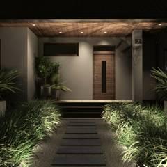 Strefa wejściowa ogrodu nocą: styl , w kategorii Ogród zaprojektowany przez STTYK Pracownia Architektury Wnętrz i Krajobrazu