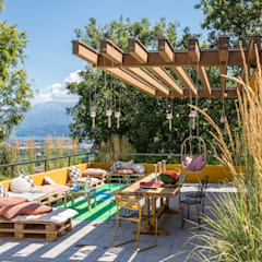 Roof terrace by Moretti MORE, Eclectic