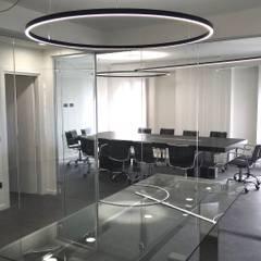 OFFICES PALAZZO PELLESINA: Studio in stile  di DCD | DAVIDE CASSINI DESIGN