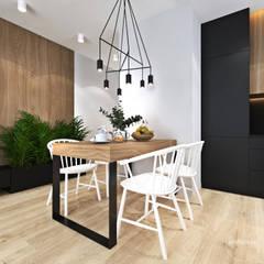 Mieszkanie z zielonym akcentem: styl , w kategorii Jadalnia zaprojektowany przez Ambience. Interior Design