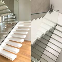 Kragarmtreppe aus Corian mit Stahlwange:  Treppe von Siller Treppen/Stairs/Scale