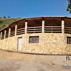 Country house by Flora Flor do Campo Pedras e Paisagismo