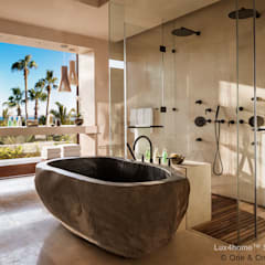 Freestanding stone bathtub - River stone tub: tropical Bathroom by Lux4home™ Indonesia