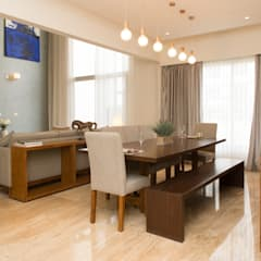 Living Room of completed project 1:  Dining room by Atom Interiors,Modern
