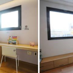 3세대 주택의 기능을 가진 고급 모던주택: 더존하우징의  침실