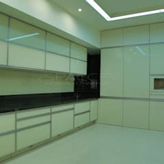 """""""Hidden Harmony"""":  Kitchen by SPACCE INTERIORS"""
