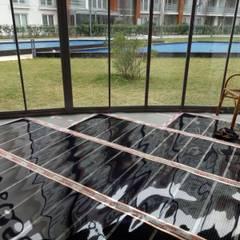 Karbonik ısıtma sistemleri – Kış bahçesi ısıtma | kapalı balkonlarda zeminden ısıtma: klasik tarz tarz Kış Bahçesi
