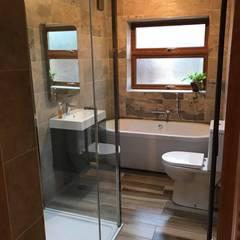full view of bathroom: modern Bathroom by Square Designs