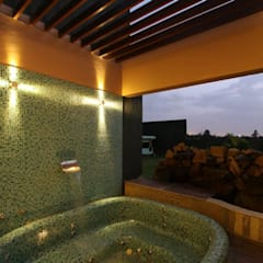 WEEKEND HOUSE,TAPOVAN:  Bathroom by SPACCE INTERIORS