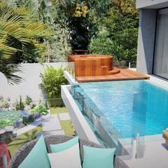 Piscina borda infinta e ofurô: Piscinas  por Trivisio Consultoria e Projetos em 3D