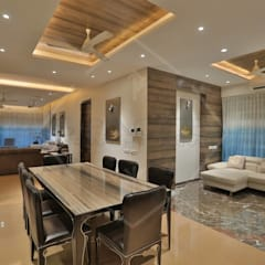 Dining room by SPACCE INTERIORS