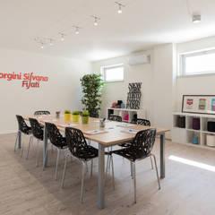 Headquarter GIORGINI SILVANO FILATI: Studio in stile in stile Industriale di B+P architetti