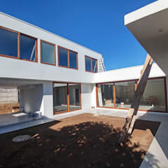 Casa Lomas De Montemar: Casas unifamiliares de estilo  por Lau Arquitectos