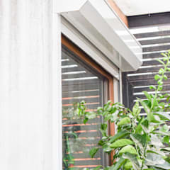 Wooden windows by Arqbau Ltda.
