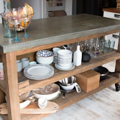 A salvage island with open shelving and a stainless steel top adds personality:  Kitchen by ADORNAS KITCHENS