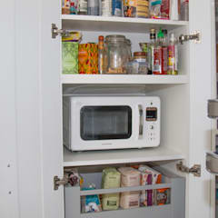 Even the under stairs cabinet has been transformed in to a useable space:  Kitchen by ADORNAS KITCHENS