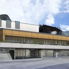 Primo Premio concorso pubblico: edificio scolastico polifunzionale: Casa di legno in stile  di Architetto Libero Professionista