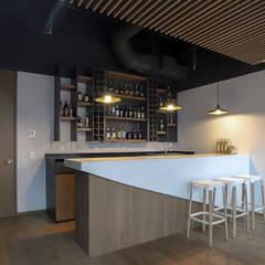 Oficinas Corporativas La Madrileña - Eskema Arquitectos: Estudios y oficinas de estilo  por Eskema
