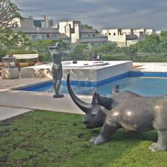 Reforma de piscina e spa: Piscinas de jardim  por Raul Hilgert Arquitetura de Exteriores