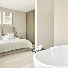 Master Bedroom with open plan bath area:  Bedroom by Tailored Living Interiors