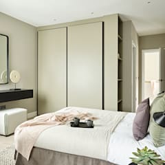 An urban chic mews in Fulham:  Bedroom by Tailored Living Interiors