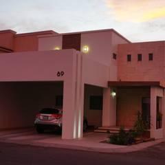 Volumetrías en fachada.: Casas unifamiliares de estilo  por GPro - Gabinete de Proyectos