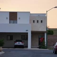 Fachada principal: Casas unifamiliares de estilo  por GPro - Gabinete de Proyectos