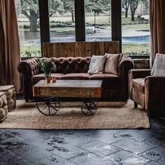 Armonía perfecta.: Salones de estilo  de Muebles Marieta