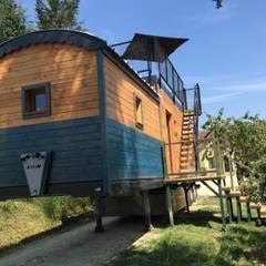 Maison Nomade: Maisons de campagne de style  par Jardin boheme