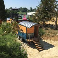Maison Nomade: Maisons préfabriquées de style  par Jardin boheme