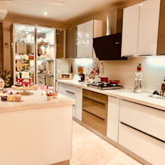 Luxury Has A New Address: modern Kitchen by Crosscurrents interiors private limited