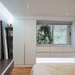 Apartamento en Chulavista: Cuartos de estilo  por RRA Arquitectura, Minimalista Madera Acabado en madera