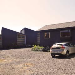 Cabañas Algarrobo: Casas unifamiliares de estilo  por m2 estudio arquitectos - Santiago