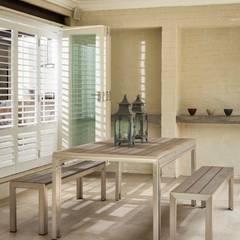 Patio / Braai Area by Deborah Garth Interior Design International (Pty)Ltd