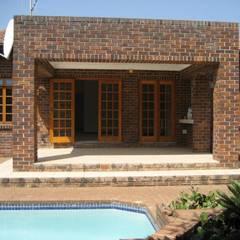 Dark face brick exterior by Deborah Garth Interior Design International (Pty)Ltd