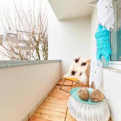 Möbliertes Appartement - Balkon NACHHER:  Terrasse von Tschangizian Home Staging & Redesign