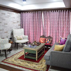 Brick Wall: rustic Living room by InDeCo