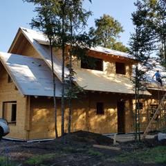 Construcción de Casa de madera en Pucón, Chile.: Casas de estilo  por Patagonia Log Homes - Arquitectos - Neuquén