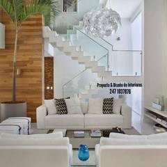 : Salas multimedia de estilo  por PROYECTO & DISEÑO DE INTERIORES,
