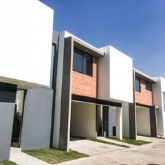 Tren de Fachadas espacio 13: Conjunto residencial de estilo  por Trignum Arquitectura