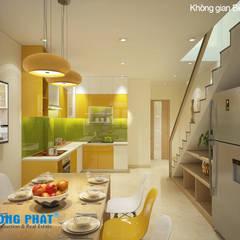 KTS đã tận dụng khoảng trống dưới chân cầu thang để đặt các tủ kệ.:  Phòng ăn by Công ty TNHH Thiết Kế Xây Dựng Song Phát