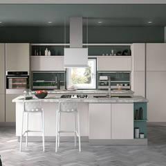Modelos de cozinhas com ilha , península ou mesa refeições: Armários de cozinha  por Area design interiores - cozinhas em Braga