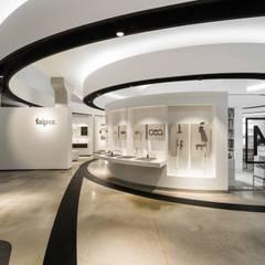 Showroom de materiales en Santiago de Compostela: Espacios comerciales de estilo  de Imaisdé Design Studio