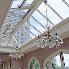 A striking solid construction orangery featuring doors with bronze inserts.:  Conservatory by Vale Garden Houses