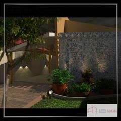 Detalhes da fachada CASA A\R: Casas familiares  por Aúra Arqstudio