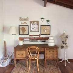 Estudio: Estudios y despachos de estilo clásico por Nancy Trejos
