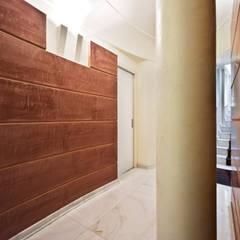 Luxury Interior Design: Ingresso & Corridoio in stile  di Studio Merlini Architectural Concept
